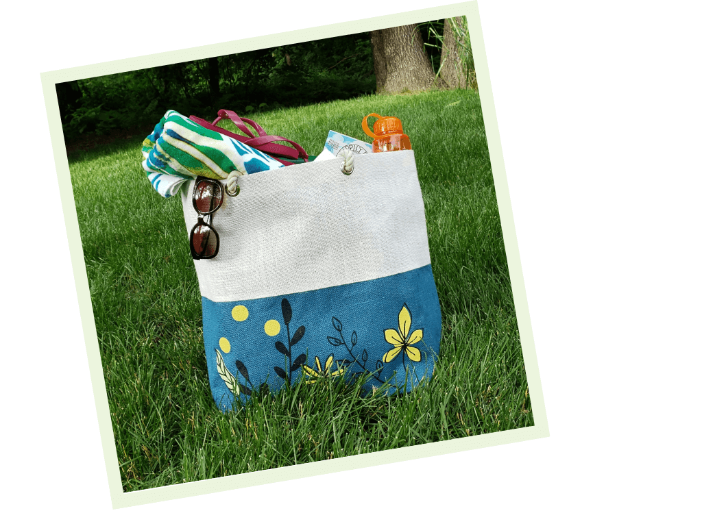 Burlap tote bag lying on the grass