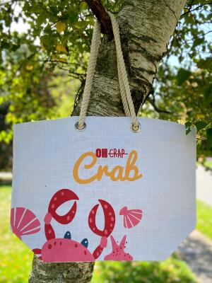 Burlap tote bag hanging on tree