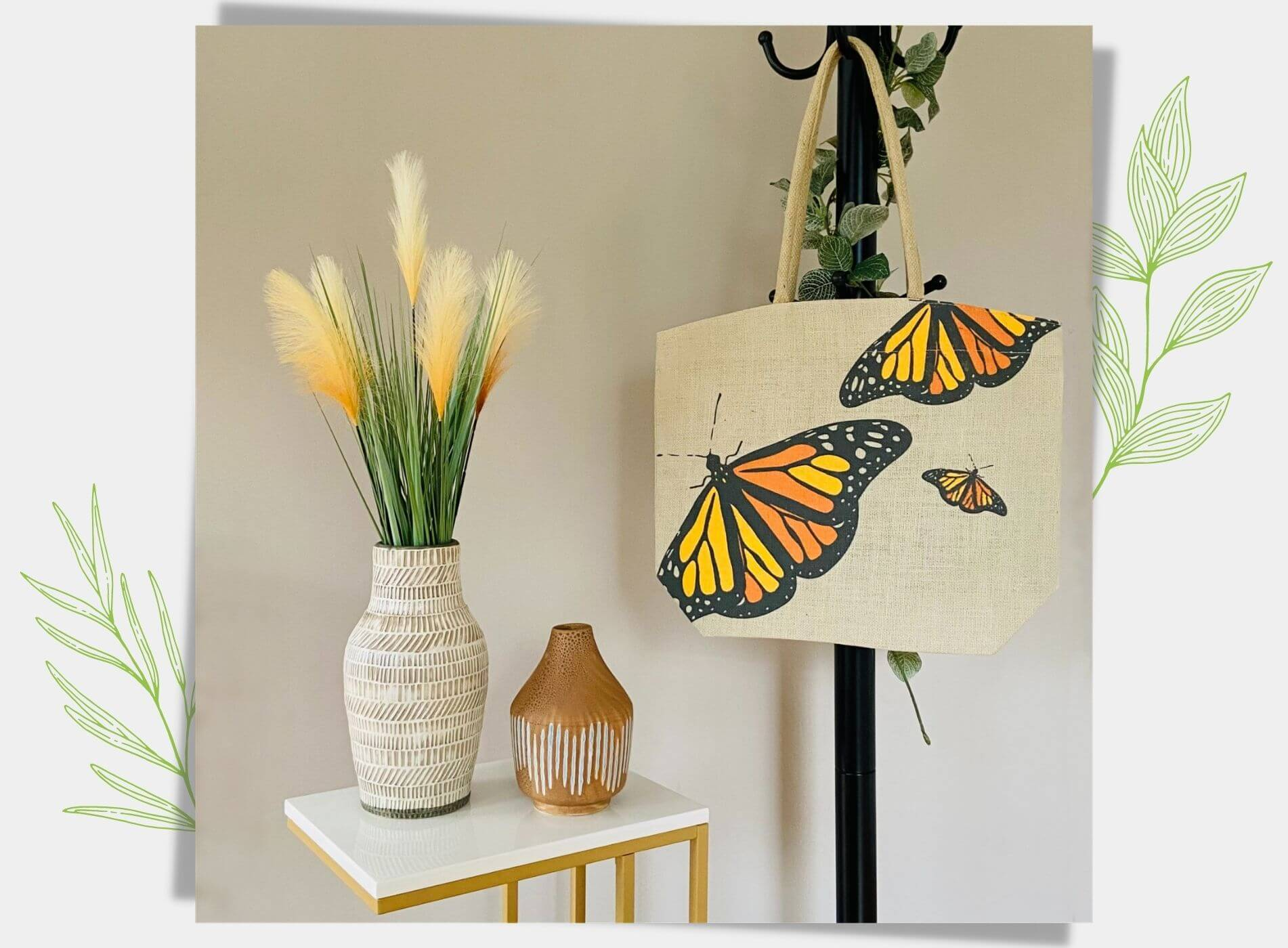 Burlap tote bag with butterfly print hanging on a stand